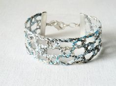 bracelet handmade bobbin lace out of bead yarn blue by UliBaysie, €24.90