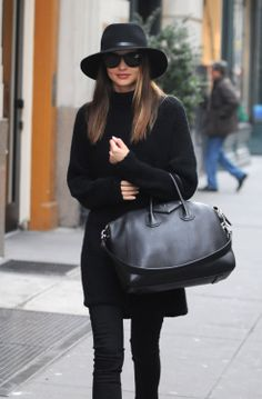 SHOP THE LOOK : All-Black Miranda Kerr wearing an all-black outfit while out in New York, consisting of black leggings and a roll-neck jumper - which she styles with a matching supersized black bag.