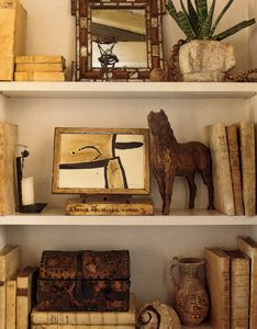 Natural/handicraft items arranged with books covered in natural brown papers...