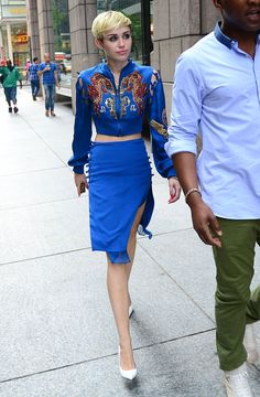 June 27, 2013: Miley Cyrus is seen arriving at Sony Studios in NYC in a blue Emilio Pucci embroidered silk bomber jacket and matching skirt from the Spring 2013 collection. She accessorized with her favourite pair of white pointed-toe Céline heels.