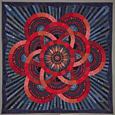 Cinnabar and Indigo by Judy Mathieson   First place in Innovative Pieced Category at Houston Quilt Festival ?2009