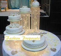 Wedding Cake Stand Cascade waterfall crystal set of 5 wedding acrylic cake stands with a battery operated LED light.