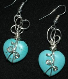 Wire wrapped turquoise heart earringso by annabelle