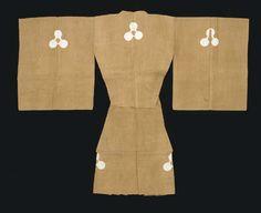 Japan | Suo Noh Costume  Meiji-Showa period (first half 20th century)  Rice-cake design on tea-brown ground; hemp with stenciled paste-resist patterning Suo 27¼ x 67in. (69.5 x 170cm.); hakama 35¼in. (89.5cm.) long (2)
