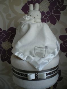 White 3 tier nappy cake with a beautiful Miffy comfort blanket