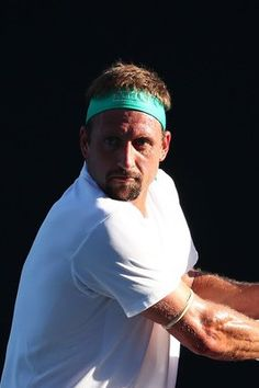 Day 1: Tennys Sandgren of the United States plays a backhand in his first round match against Yoshihito Nishioka of Japan during day one of the 2019 Australian Open at Melbourne Park on January 14, 2019 in Melbourne, Australia.