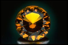 Photograph of a round brilliant-cut citrine (G3732) from the National Gem Collection