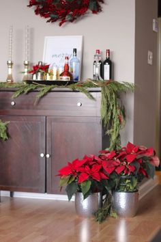 Bar cart for christmas, add poinsettias to your bar cart and garland