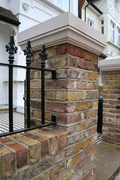 Brick pillar and black railings in contemporary London front garden. Black Railing, Wall Railing, Victorian Front Garden, Garden Railings, Modern Fence Design, Small Front Gardens, Pillar Design, Edwardian House, Wrought Iron Fences