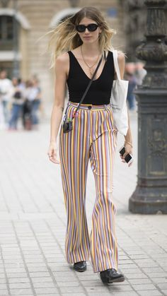 Keep the top neutral and the bottom flashy with a pair of colorful pinstripe pants. | For more style inspiration visit 40plusstyle.com