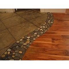River Stone Transfer....i really like this, it's something different, unique & one i have never seen before to seperate the flooring for different rooms, instead of those metal things & the carpet right up against a different color carpet