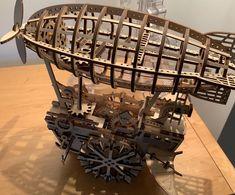 Puzzle en bois 3D Maquette DIY Puzzle mecanique Mecapuzzle DIY  Loisirs créatifs Idée cadeau Puzzle Puzzle, Chandelier, Ceiling Lights, Lighting, Home Decor, Basket, Creative Crafts, Gift, Puzzles