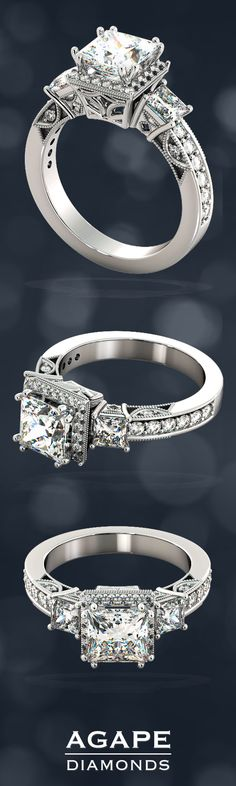 This breathtaking Three-Stone Princess Cut engagement ring is truly remarkable as the see-through openings between the filigree crescents reflect the brilliance of the stones while the pavé crown takes the ring to new heights making this ring idyllic for your bride. Exquisitely made to order according to your selection of precious metal, this Engagement Ring comes as pictured with a 1.5Ct Princess Cut simulated diamond and 1.13Ct in side stones. (Total Carat Weight: 2.63 CTW).