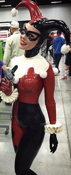 Red and black latex Harley Quinn cosplay catsuit.  Amazing detail and fit - our hats off to the maker!. Buy the supplies to make this: http://mjtrends.com/pins.php?name=red-and-black-latex-sheeting-for-harley-quinn