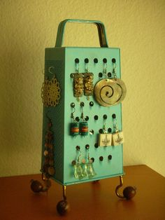 DIY - Grater (not a typo) Earring Stand.  Visit us at www.millenniumwasteinc.com