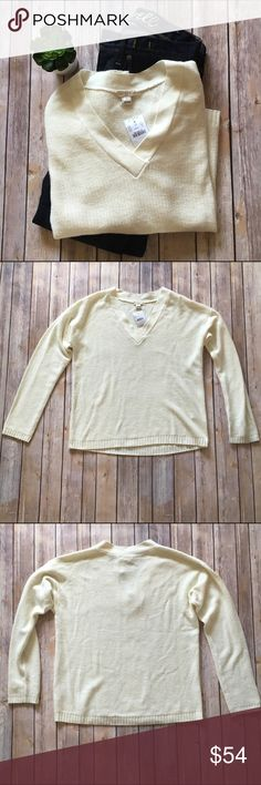 J. Crew Cream V Neck Sweater This is a beautiful J. Crew Factory cream b neck sweater! 37% viscose, 35% nylon, 28% merino wool. Brand new with tags.  NO TRADES NO OFF SITE  ✅POSH RULES ONLY ✅DOG FRIENDLY, SMOKE FREE HOME ✅FAIR OFFERS  PLEASE USE OFFER BUTTON!  ❓ASK IN THE COMMENTS!   BUNDLE 2+ ITEMS & SAVE!!!!! J. Crew Sweaters