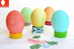 Use soda or water bottle tops (with or without ribbon) to hold Easter eggs, could glue caps to a tray or piece of cardboard or pretty plate to stablize them.