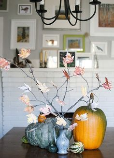 Here's an easy DIY craft for you: grab some leaves from the backyard, whip out some craft paint or thread, and go to town. If your budget doesn't allow for buying store-bought decorations, this is a cheap alternative that do-able and fun.