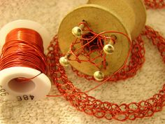 Spool Knitting With Copper Wire by cavalaxis, via Flickr