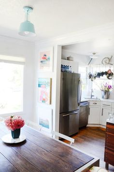 Colorful contemporary art and energetic boys (and dogs) make this cozy Cali beach cottage vibrant. With a backyard art studio and the indoor climbable feature. it's all about fun.