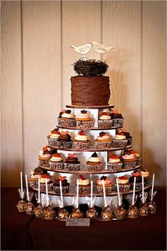 Rustic wedding dessert tower with a layer of cake, cupcakes, and cake pops #wedding #weddingdessert #desserttable #rustic #cake