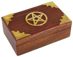 """This box is carved in a simple design, with a hinged lid. Decorated with metal inlays and a five pointed pentagram at its top, it is a beautiful peace for the home and altar. 4"""" x 3"""" - See more at: http://www.mythical-gardens.com"""