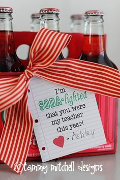 teacher gift ideas ~ K's preschool teachers. Made my own tags to make it look like kids writing on writing paper and then had her sign her name. Used GUS soda. The teachers loved them and though the Grown Up Soda was a great touch.