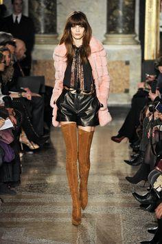 Emilio Pucci. Those boots are AMAZING!!