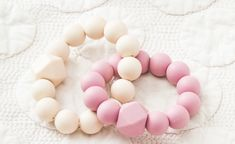 Dusty Rose and Ivory Chew Rings from Indie & Chic. Indie & Chic teething rattles are fun to give and practical for little babes. Babies love to entertain themselves with our teething rattles! BPA free, food grade silicone beads are strung and knotted on durable satin string. Our wooden beads and rings are made in America and conditioned with a coconut oil/beeswax salve. Tactile Stimulation, Teething, Wooden Beads, Dusty Rose, Food Grade, Baby Love, Free Food, Coconut Oil, Indie