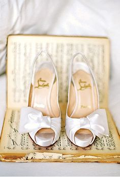 Brides.com: Wedding Shoes with Bows. Traditional White Christian Louboutin Slingbacks. Dress up a down-home barn bash with sophisticated, bow-adorned satin slingbacks.  Browse more photos from this rustic Lake Tahoe wedding.