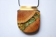 Britta Boeckmann from the Etsy shop BoldB is doing some amazing pieces that incorporate wood.