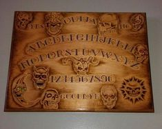 Check out our ouija board selection for the very best in unique or custom, handmade pieces from our shops. Ouija, Bamboo Cutting Board, Mood Boards, Carving, Handmade, Etsy, Hand Made, Wood Carvings, Sculptures