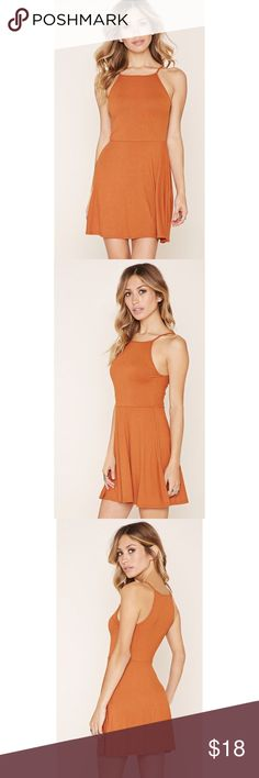 """NWT. Ribbed cami mini dress NWT. Ribbed cami mini dress. Featuring cami straps, mini length and a flared hem. About 31"""" long. Size: S. Color: Rustic orange. Sorry, no trades. Like the item but not the price, feel free to make me a reasonable offer using the offer button. Dresses Mini"""