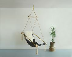 OVIS HANGING CHAIR BROWN / Get started on liberating your interior design at Decoraid (decoraid.com).