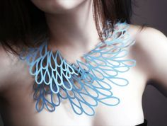 """A new concept in wearable art - The Air Tattoo! This is hand-drawn patterns turned into magnificent paper jewelry, resembling an """"air-like tattoo."""" It's made from an eco-friendly, water and tear-resistant paper that almost feels leather-like. Comes in 4 different styles!"""