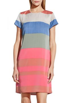 Pairing this fun striped dress with flats and a blazer for a vibrant spring look.