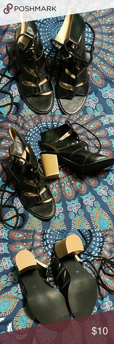 "Black heels Black, lace up shoes with a clunky 2"" heel.  These shoes are NWOT. The laces are really long but the shoes are super cute. Just not my style. They are a 38 (China) so they are a US size 7. Shoes Heels"
