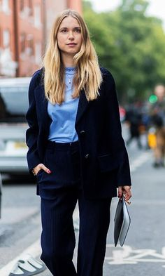 London Fashion week street style spring 2018: Pernille Teisbaek in a navy corduroy suit, alexandra carl plaid coat, and a blue bag