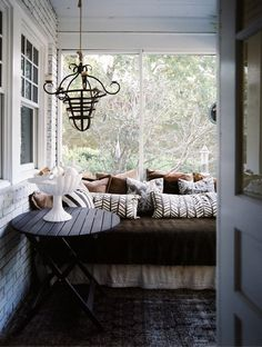 Now THIS is how to treat a sleeping porch. Via Etxekodeco.