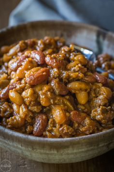 Best BBQ Baked Beans with Beef, this is hands down the most popular recipe I've made all year, so, so tasty! Also known as Cowboy Beans or Southern Baked Beans   gluten free and dairy free   from noshtastic.com