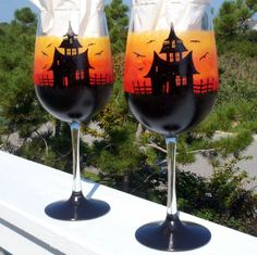 Set of two hand painted haunted house and graveyard Halloween glasses. A spooky sunset scene complete with bats and scarey tree in the graveyard.