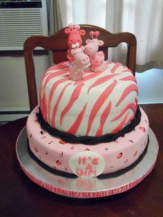 Animal print safari it's a girl baby shower cake. Super cute.