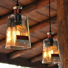 I would take off the label but cook idea. Recycled 1800 Tequila Bottle Pendant Lamp with old fashioned light bulb Diy Bottle Lamp, Bottle Art, Bottle Crafts, Bottle Chandelier, Chandelier Ideas, Old Bottles, Liquor Bottles, Glass Bottles, Recycled Bottles