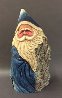 Hello! My Name is Greg Macdonald and I create original hand carved works of Holiday Folk Art!  I have been a full time wood carver for close to 20 years. I also sell at art fairs throughout the Midwest. My carvings have found homes in collections in all 50 states and several foreign countries.  This piece is a hand carved large rustic Santa from 100 year old cottonwood bark. The bark of a Cottonwood tree is unique in that it continues to thicken as the tree grows, sometimes 4 thick and…