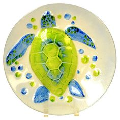 Round multicolor platter with a sea turtle design. Product: PlatterConstruction Material: GlassColo...