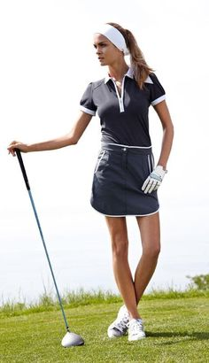 White and navy meet again on the course | womens golf outfits | golf clothes | sport | golf | attire | golf dress