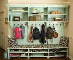 Mudroom wall that has space for shoes, bench for sitting, hooks for coats and backpacks and storage above.?
