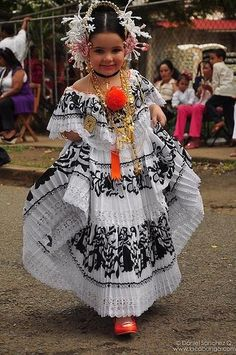 """Panamanian women learn to carry their folkloric dress """"Pollera"""" since they are small. It is something special to proudly wear this dress with all its accessories, and a ritual to get dressed in it.  Here is the vivid example of such pride!"""