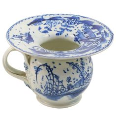 English Pearlware Lady's Spittoon  England  circa 1790  A rare English pearlware pottery blue and white Lady's Spittoon decorated with a Oriental landscape, double twist handles with flowers florettes