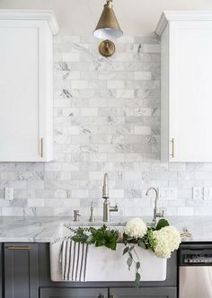 Two-toned gray and white cabinets, marble subway tile, Carrara countertops, a big farmhouse sink, and brass hardware give this kitchen a classic yet modern look. backsplash Gray and White and Marble Kitchen Reveal - Maison de Pax Kitchen Remodel, Kitchen Decor, Modern Kitchen, New Kitchen, White Marble Kitchen, Kitchen Redo, Home Kitchens, Kitchen Renovation, Kitchen Design